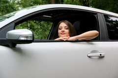 Woman looking in the car Stock Photography