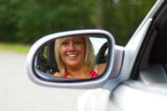 Woman looking in a Car Mirror Royalty Free Stock Image