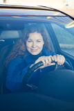 Woman looking through the car windshield glass Stock Photo
