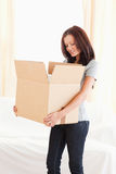 Woman looking into cardboard Royalty Free Stock Photo