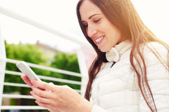 Woman looking at cellphone Royalty Free Stock Photos