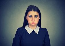 Woman looking childish while being upset stock photos
