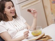 Woman looking at chocolate Stock Images
