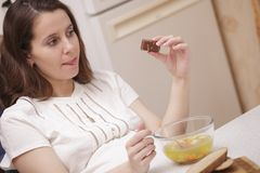 Woman looking at chocolate Royalty Free Stock Image