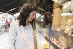 Woman looking at showcase royalty free stock photos