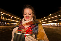 Woman looking on Christmas gift box on Piazza San Marco, Venice Stock Image