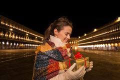 Woman looking on Christmas gift box on Piazza San Marco, Venice Stock Photo
