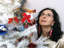 Woman looking Christmas tree Royalty Free Stock Image