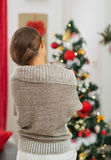 Woman looking on Christmas tree. Rear view Stock Images