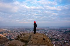 Woman looking at the city in the Afyonkarahisar Castle in Turkey. Standing on a rock ine the ruins Royalty Free Stock Photo