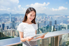 Woman looking at the city map Stock Image