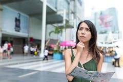 Woman looking for city map and thinking the location Royalty Free Stock Photography