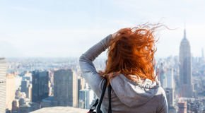 Woman looking at the cityscape Stock Photos