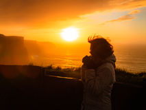 Woman looking at cliffs of Moher sunset in Ireland Royalty Free Stock Photo