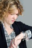 woman looking at clock Royalty Free Stock Images
