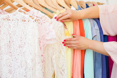 Woman looking at the clothes on  clothing rack Royalty Free Stock Photography