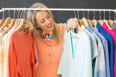 Woman looking at clothes on the clothing rack Royalty Free Stock Photo