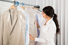 Woman looking at clothes in shop Royalty Free Stock Photos