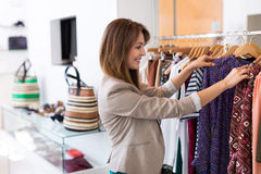 Woman looking at clothing in a boutique Stock Photography