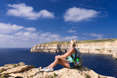 Woman looking at coastline near Azure Window on Gozo Island Royalty Free Stock Photography