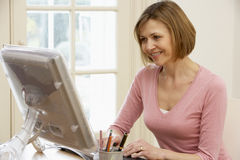 Woman Looking At Computer Screen Royalty Free Stock Image