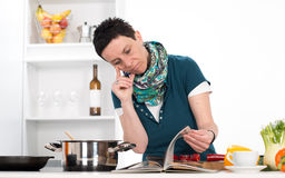 Woman looking for cooking recipe Royalty Free Stock Photography
