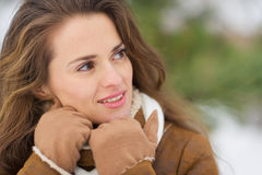 Woman looking on copy space in winter park Royalty Free Stock Image