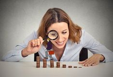 Woman looking at corporate employee walking up coin stack ladder Stock Photos