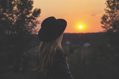 Woman looking at countryside sunset Stock Image