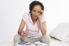 Woman Looking At Credit Cards Royalty Free Stock Photos