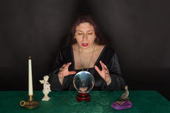 A woman is looking into a crystal ball Royalty Free Stock Photo