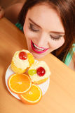 Woman looking at delicious sweet cake. Gluttony. Royalty Free Stock Photography