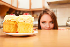 Woman looking at delicious sweet cake. Gluttony. Royalty Free Stock Photos