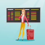Woman looking at departure board at the airport. Stock Images
