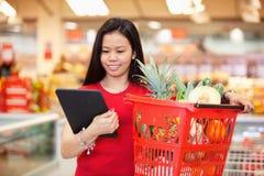 Woman looking at digital tablet Stock Image