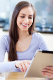 Woman looking at digital tablet Royalty Free Stock Photo