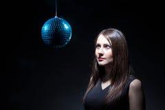 Woman looking at disco ball Stock Image