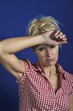 Woman looking discouraged. A blond Woman looking discouraged Royalty Free Stock Photo