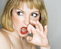 Woman looking disgusted. Royalty Free Stock Image