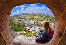 Woman looking into the distance against the background of incredible landscape. With  mountains , geological structures in Goreme, Cappadocia,  Turkey Stock Photography