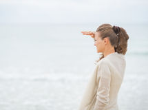 Woman looking into distance on beach Stock Images