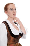 Woman looking into distance - redhead isolated in a dirndl Stock Image