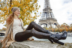 Woman looking into distance while sitting on parapet in Paris Royalty Free Stock Photos
