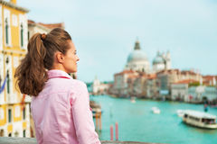 Woman looking into distance in venice, italy Stock Photos