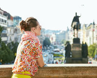 Woman looking into the distance at Wenceslas Square in Prague Stock Photos