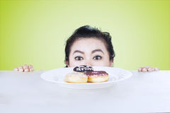 Woman looking at donuts on the table Royalty Free Stock Photo
