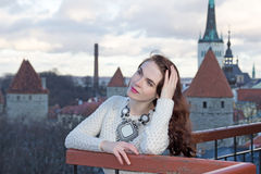 Woman looking down at the city of Tallinn Stock Photography