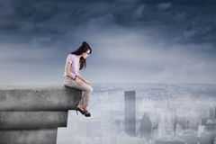 Woman looking down from the rooftop Royalty Free Stock Photos