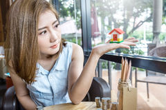Woman looking at dream house Stock Images