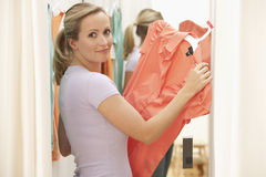 Woman Looking at Dress royalty free stock photos